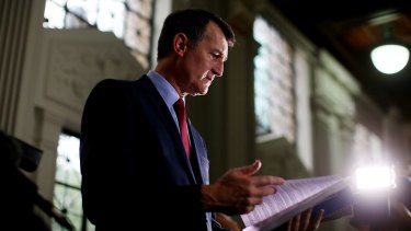 Lord Mayor Graham Quirk peruses the 2015-16 Brisbane City Council Budget before handing it down on Wednesday.
