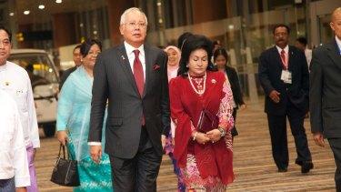 Malaysia's Prime Minister Najib Razak walks with his wife, Rosmah Mansor.