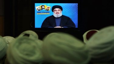 Shiite and Sunni clerics listen to Hezbollah leader Sayyed Hassan Nasrallah, via video link, during a ceremony to honour fallen Hezbollah leaders, in Beirut, Lebanon, on Tuesday.
