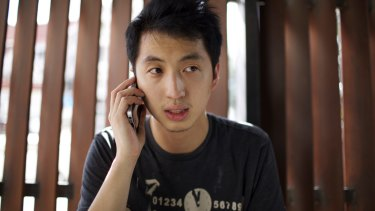 Hong Kong photojournalist Hok Chun Anthony Kwan with dual Hong Kong-Canadian citizenship speaks on the phone in Thailand in August after he was released on bail.