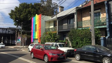 An Enmore resident has painted a rainbow down the front facade of his property in support of same-sex marriage.