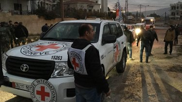 A convoy containing food, medical items, blankets and other materials reaches Madaya on Monday. The town has been blockaded for months by government troops and the Lebanese militant group Hezbollah.