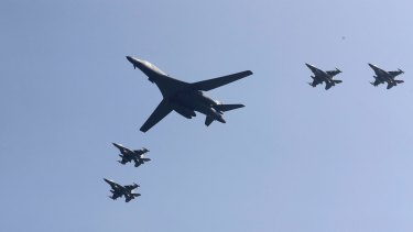 A US B-1 bomber flanked by fighter jets during a show of force over the Korean Peninsula in September 2016.
