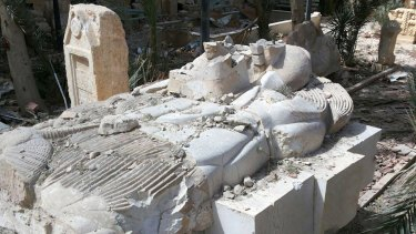 The destroyed Lion of al-Lat statue outside the damaged Palmyra Museum in December.