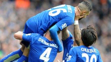 Fairytale: Leicester's Riyad Mahrez, top, celebrates after scoring against Swansea City.