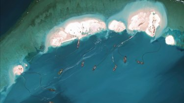 A satellite image shows dredgers working at the northernmost reclamation site of Mischief Reef, part of the Spratly Islands, in the South China Sea in March 2015.