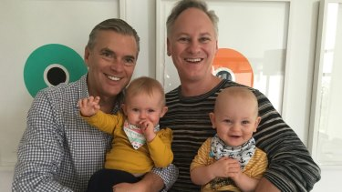 Dr Shane Woods and his partner Scott Koopman with their twins, born via surrogate.