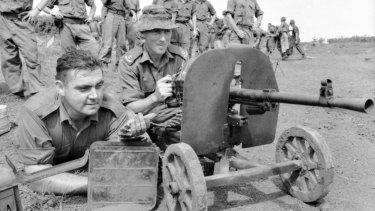 Jack Kirby (left), and Harry Smith test-fire a Goryunov SG43 7.62 x 54mmR Soviet-made Chinese communist heavy machinegun captured at Long Tan.