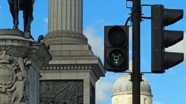 A gender neutral pedestrian light at Trafalgar Square, London.