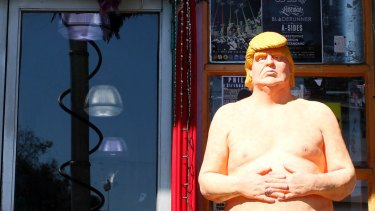 A statue of presidential hopeful Donald Trump is placed outside a shop in Los Angeles.
