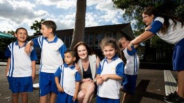 Melissa Proctor, Principal of Bass Hill Public School with students, Kory Allen, Daniel Glynatis, Maher Tahan, Roukaya Maarbani, May Ali and Nourhan Ghalayini, in Sydney.