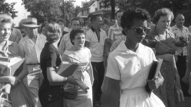 Hazel Bryan, centre, her face twisted in anger, is part of the crowd taunting Elizabeth Eckford, right foreground, as she walks in front of Central High School in Little Rock on Sept. 4, 1957. National Guardsmen who blocked the main entrance wouldnot let Eckford enter. She was the first to try to break the school's color barrier. Eight others later were also turned away.