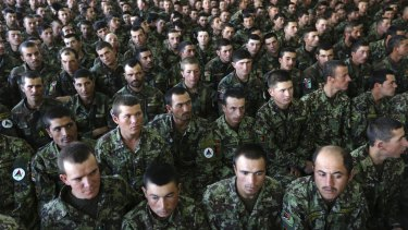 New members of the Afghan National Army attend their graduation ceremony at the Afghan Military Academy in Kabul last year.
