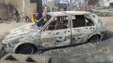 A survivor who sheltered in a tree says he watched Boko Haram extremists firebomb huts and listened to the screams of children as they were burnt to death near Maiduguri on Saturday.