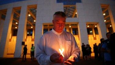Andrew Stojanovski during the candlelight vigil .
