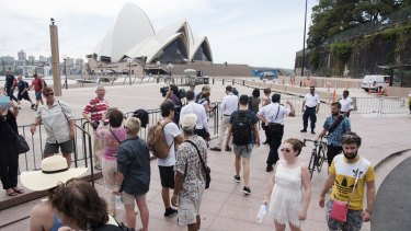 Tourists mill around, unable to access the Sydney Opera House.