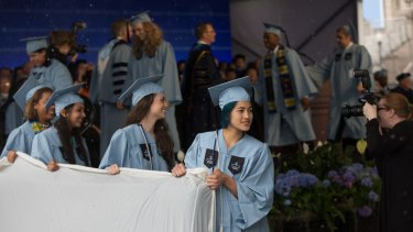 Emma Sulkowicz leads a group carrying a mattress during Class Day for seniors at Columbia University in 2015. To protest the school's handling of her sexual assault complaint against a classmate, Sulkowicz  carried a mattress around campus all year.