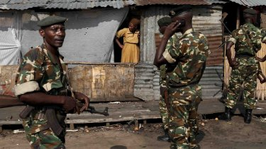 Soldiers stand guard during a protest against Burundi President Pierre Nkurunziza in Bujumbura on Tuesday.