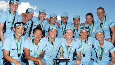 The NSW Breakers pose after winning the WNCL final.