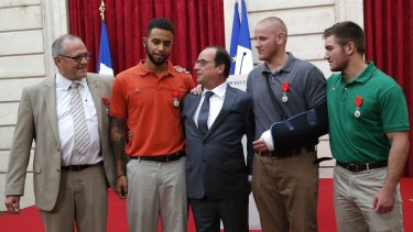 President Francois Hollande (centre) presenting Anthony Sadler, Spencer Stone and Alek Skarlatos with Legion of Honour medals.