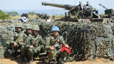 Taiwan's military rest behind self-propelled Howitzers during the annual Han Kuang exercises in Hsinchu.