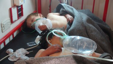 Young victims of the suspected chemical attack are treated in hospital.