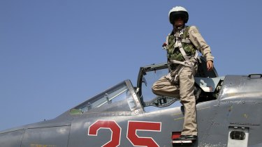 A Russian army pilot poses on the cockpit of SU-25M jet fighter. Russia has insisted its air strikes are targeting Islamic State and al-Qaeda's Syrian affiliates.
