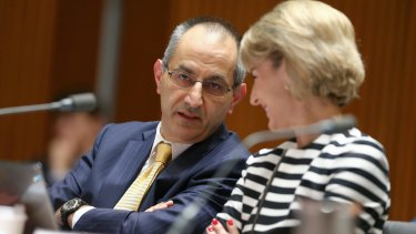 Secretary of the Department of Immigration and Border Protection Michael Pezzullo and Senator Michaelia Cash in discussion during estimates on Monday.