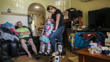Trevor and Cherie Dell with 3-year-old daughter Abbey who suffers a rare genetic disorder, CDKL5.