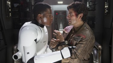 John Boyega, left, says the next <i>Star Wars</I> instalment will be considerably different in tone to the <i>The Force Awakens</I>, in which he starred with Oscar Isaac.