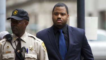 Officer William Porter, right, one of six Baltimore city police officers charged in connection to the death of Freddie Gray, arrives at court last year.