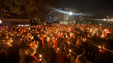 A candlelight vigil is held for Ms Connelly a month after her murder.