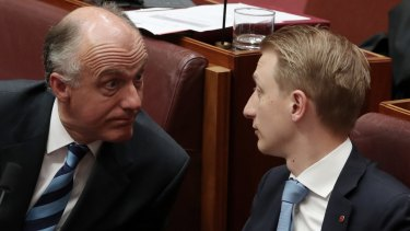 Senator Eric Abetz and Senator James Paterson, pictured on Tuesday, have supported a bill that would allow parents to pull their children out of class if they are being taught about same-sex relationships.