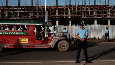 Prepared: Philippine National Police stand guard along the national highway during a security rehearsal ahead of the Pope's visit.