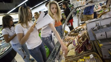 """Members of """"Eat the Russian food"""" movement check food at a Moscow food store this week."""