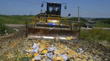 Illegally imported food is destroyed in the Belgorod region, Russia, on Thursday.