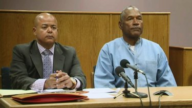 OJ Simpson with his attorney, Malcolm LaVergne, left, appearing via video for his parole hearing.
