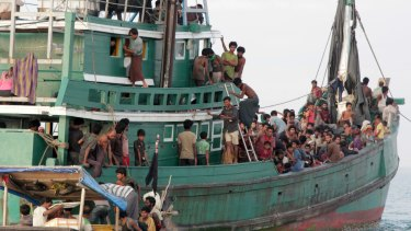 Rohingya and Bangladeshi refugees await rescue by Acehnese fishermen off East Aceh, Indonesia, in May 2015.
