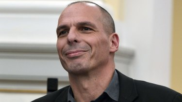 Greek Finance Minister Yanis Varoufakis smiles during the civil oath ceremony at the Presidential Palace in Athens on Tuesday.