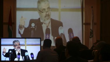 Hamas leaders and supporters in Gaza City listen to Khaled Mashaal, the outgoing Hamas leader, launch a new manifesto from Doha, Qatar, in May.