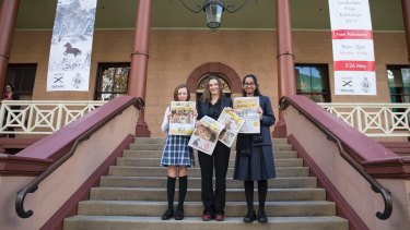 Ten-year-old Grace Gregson from year 5 at Seaforth Public School, <i>Crinkling News</i> founder and editor Saffron Howden, and 15-year-old Diya Mehta from year 10 at MLC, outside NSW Parliament House after speaking at the Senate media inquiry.