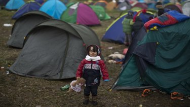 A Syrian refugee child in the makeshift camp for asylum seekers in Roszke, southern Hungary, on Thursday.