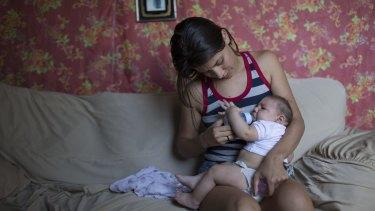 Angelica Pereira feeds her daughter Luiza, who was born with microcephaly, in Santa Cruz do Capibaribe, Brazil.