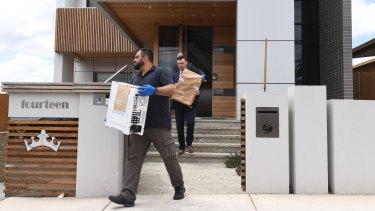 NSW Police remove evidence from the home of former Auburn deputy mayor Salim Mehajer in Sydney.