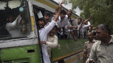 Activists of India's Congress Party's youth wing shout slogans from a bus.
