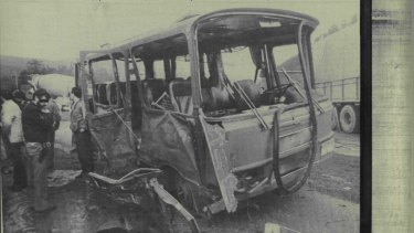 A policeman and other people look at a military bus that was destroyed after a bomb, which was placed in a parked car, exploded as the bus was passing by near Bilbao, Spain, in 1984.
