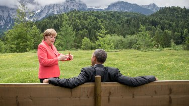 German Chancellor Angela Merkel chats with US President  Barack Obama outside the Elmau Castle.