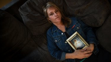 Deborah Pum, with a picture of her baby Cory who was stillborn at Bacchus Marsh hospital.