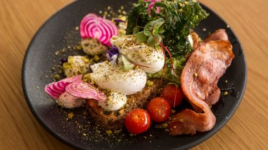 Smashed avo with eggs and bacon at Briggs' favourite haunt, The Re-Up in Moonee Ponds.