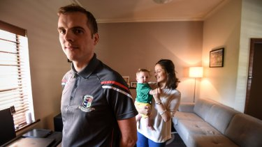 Irishman Liam Lenihan with his Australian partner, Tanya Grausam, and their seven-month-old son, Henry, at home in Hawthorn.